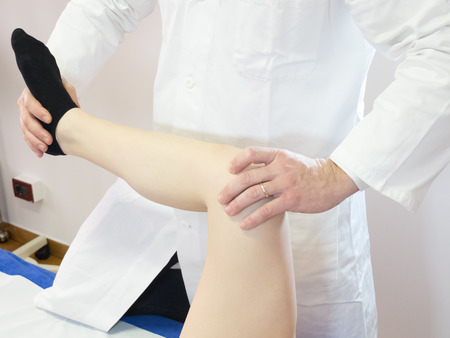 pains: Physiokinesitherapy technique applied to the knee of a woman