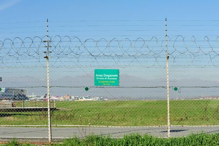 airport customs: Customs Area signboard on a barbed wire at the airport Stock Photo