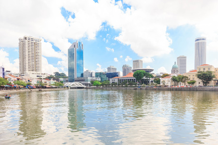 riverside county: SINGAPORE - MAY 16, 2016. View of Singapore river with downtown buildings in the background.