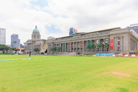 cricket field: SINGAPORE - MAY 16, 2016: Old Supreme Court and National Gallery in Singapore. View from Padang, former cricket field