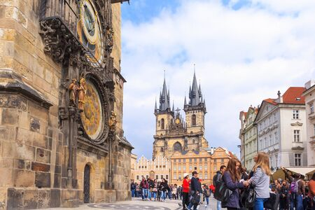 PRAGUE, CZECH REPUBLIC - 15 APRIL 2016: Group of people in the Old Town Square in front of Tyn Church and famous Astronomical Clock. Editorial