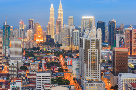 twin tower: KUALA LUMPUR - AUGUST 14, 2016: Kuala Lumpur cityscape showing Petronas twin tower, also known as KLCC building during blue hour from the top of Regalia Residence Kuala Lumpur, Malaysia. Editorial
