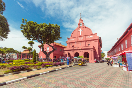 18th: MALACCA, MALAYSIA - AUGUST 12,2016: A view of Christ Church & Dutch Square on August 12, 2016 in Malacca, Malaysia. It was built in 1753 by Dutch & is the oldest 18th century Protestant church in Malaysia.