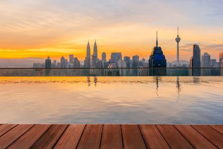twin tower: KUALA LUMPUR, MALAYSIA - AUGUST 14, 2016: Kuala Lumpur cityscape showing Petronas twin tower, also known as KLCC building during sunrise from the top of Regalia Residence Kuala Lumpur, Malaysia. Editorial