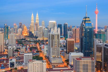 petronas: KUALA LUMPUR, MALAYSIA - AUGUST 14, 2016: Kuala Lumpur cityscape showing Petronas twin tower, also known as KLCC building during blue hour from the top of Regalia Residence Kuala Lumpur, Malaysia.