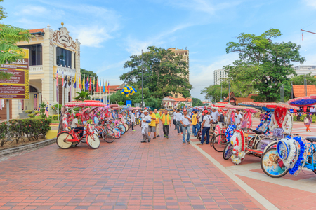 trishaw: MALACCA, MALAYSIA - AUGUST 12, 2016: The decorated trishaw parking in a Famosa Castle in Malacca,tourists and local people can seen around the Famosa Castle in Malacca
