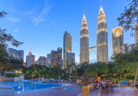 KUALA LUMPUR, MALAYSIA - AUGUST 13: Petronas Twin Towers in blue hour on August 13, 2016 in Kuala Lumpur. Petronas Twin Towers were the tallest buildings (452 m) in the world from 1998 to 2004