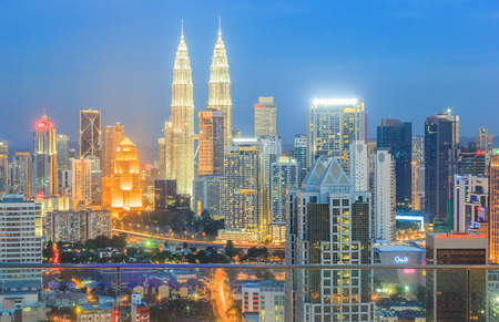 twin tower: KUALA LUMPUR, MALAYSIA - AUGUST 14, 2016: Kuala Lumpur cityscape showing Petronas twin tower, also known as KLCC building during blue hour from the top of Regalia Residence Kuala Lumpur, Malaysia.