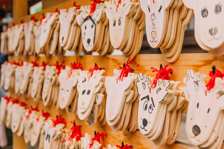 Wooden prayer tablets in Kasuga-taisha shrine in Nara. Wooden prayer tablets in Nara are uniquely design as a deer which is considered divine and sacred. Stock Photo