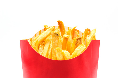 French fries  potatoes in a red paper box isolated on white background.