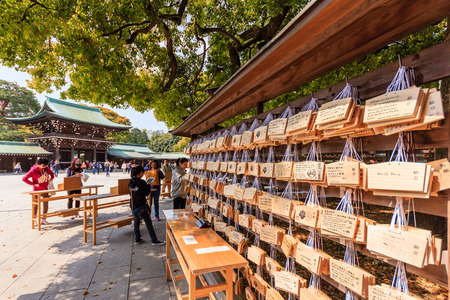 Harajuku: TOKYO, JAPAN - APRIL 19, 2014: Meiji Shrine is a shrine dedicated to the deified spirits of Emperor Meiji and his consort, Empress Shoken. Located just beside the JR Yamanote Lines busy Harajuku Station. Editorial