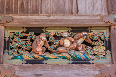 wood carvings: Famous wood carvings see no evil, speak no evil and hear no evil of the three wise monkeys at Tosho-gu wood carvings at a Store House in Nikko Tosgogu Shrine, Japan Stock Photo