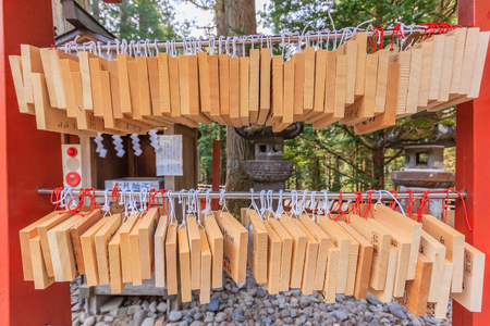 wish desire: NIKKO, JAPAN - APRIL 16, 2014: Ema plaques at a Toshogu Shrine in Nikko, Japan on April 16, 2014. Shrine visitors write their wishes on wood plates and leave them inside the Toshogu shrine in the hope that their wishes come true.