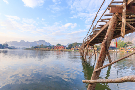 Wooden bridge across Nam Song river to riverside guesthouse at Vang vieng, Laos