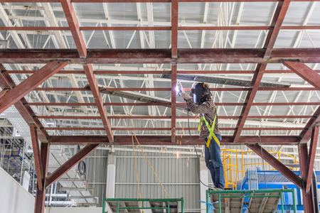 standard steel: Technicians are welding steel structure. Construction site image for the background. Construction site, low safety working condition