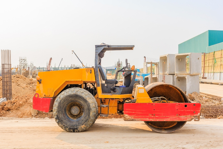 vibroroller: soil vibration roller during sand compacting works at construction site