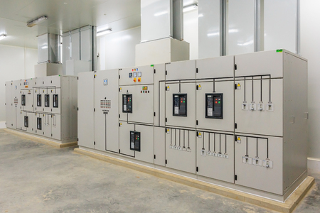 Electric control cabinet substation in a new factory plant. Stock Photo