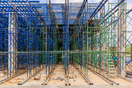 Scaffolding used as the temporary structure to support platform, form work and structure at the construction site. Also used it as a walking platform for workers. Stock Photo