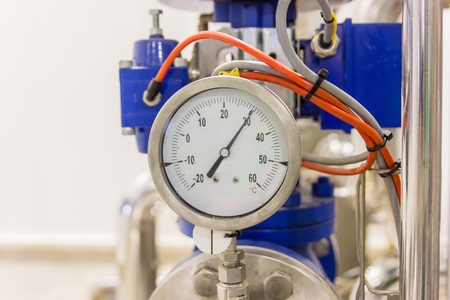 air pressure: Closeup of pressure gauge, pressure gauge for monitor condition. Pipes and valves at pharmacy industry manufacture factory.