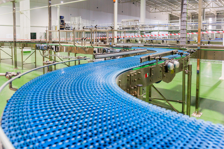 Empty conveyor belt of production line, part of industrial equipment Stock Photo