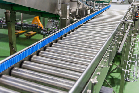 Crossing of the roller conveyor at food manufacture plant