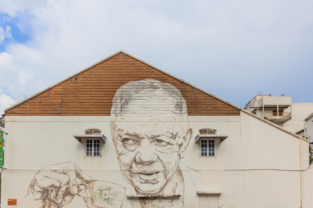 IPOH, MALAYSIA - APRIL 14, 2017: An old uncle drink coffee at Jalan Dato Maharajalela(side wall of the OLDTOWN white coffee branch facing Ipoh padang) painted by Ernest Zacharevic in Ipoh, Malaysia.