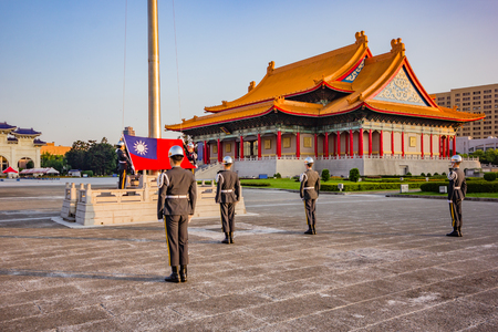TAIPEI, TAIWAN - APRIL 30, 2017 : Soldier raise the flag in the morning at Chiang Kai-shek memorial hall, a famous monument, tourist attraction and landmark of Taipei, Taiwan. Editorial