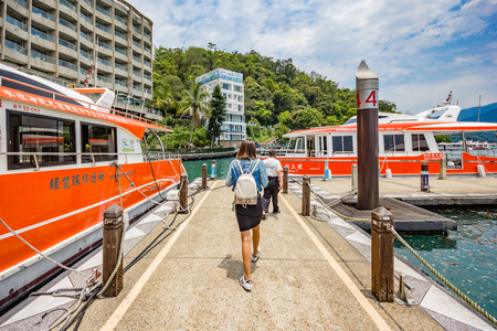 ridgeline: NANTOU, TAIWAN - MAY 01, 2017: Tourists like to visit the beautiful attractions around the sun moon lake by boat cruise from Shuishe Pier to Ita Thao Pier, and then to Xuanguang Temple Pier