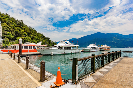Boats parking at the pier at Sun Moon Lake, Taiwan. Sun Moon Lake is the largest body of water in Taiwan as well as a tourist attraction. Editorial