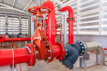 Industrial fire pump station for water sprinkler piping and fire alarm control system. Pipelines, water pump, valves, manometers.