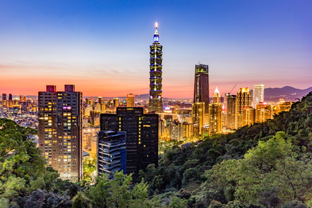Taipei, Taiwan city skyline at sunset from view of Taipei City, make a hike to the top of Elephant Mountain