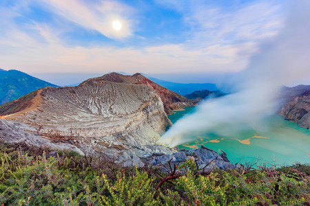 Panoramic view of Kawah Ijen Volcano at Sunrise. The Ijen volcano complex is a group of stratovolcanoes in the Banyuwangi Regency of East Java, Indonesia.