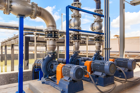 Wastewater treatment plant. A new pumping station. Valves and pipes. Urban modern treatment facilities, pipelines and pumps powerful, modern automatic system protection and control.