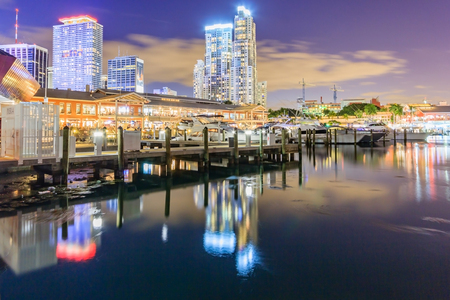 annually: MIAMI, FLORIDA, USA - DEC 31,2016 : Bayside Marketplace at dusk in Miami, Florida. It is a festival marketplace and the top entertainment complex in Downtown Miami attracting 15M people annually.