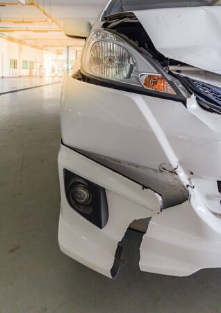 Front of white car get damaged by accident on the road