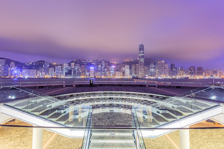 Hong Kong city skyline at sunset and twilight, panorama view Kowloon public pier, the cityscape of business and financial district, one of the worlds most significant financial centres, Asia-Pacific