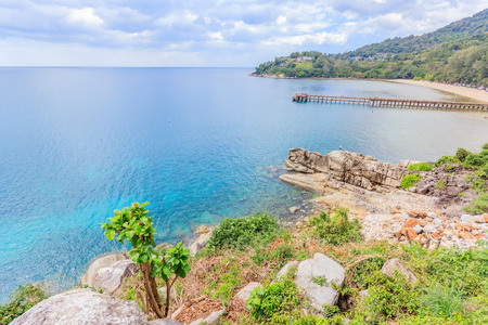 Aerial view of the beaches and rocky cape in Phuket, Andaman Sea, landscape in cloudy weather, rocks and bushes on the shore