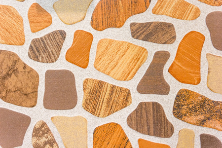 tiling: Ceramic beige or light brown tiles. Texture of floor covering in the office, store, shopping center, business center.