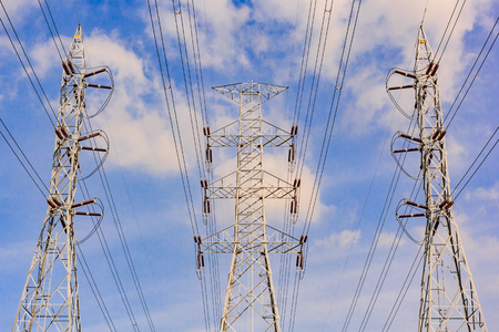 electric grid: high voltage post or High-voltage tower in blue sky background.