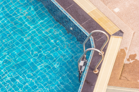 Swimming pool with metal handrail stair or Pool ladder, Top view