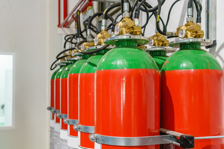 Hazard fire suppression system of a gas fire extinguishing. a closeup of the fire extinguishing system in an office building Foto de archivo