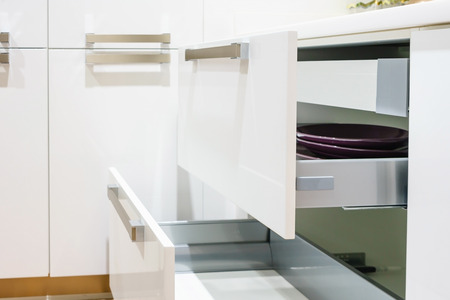 Opened kitchen drawer with plates inside, a smart solution for kitchen storage and organizing Stock Photo