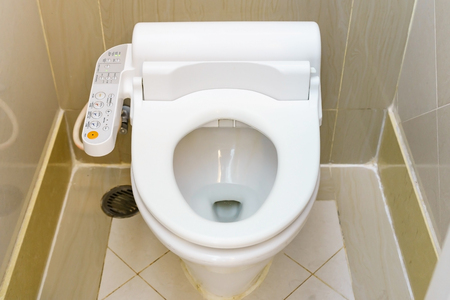 empty the bowel: Control Panel of the toilet bowl. Hygienic and high technology of the toilet bowl, automatic modern flush toilet. Stock Photo