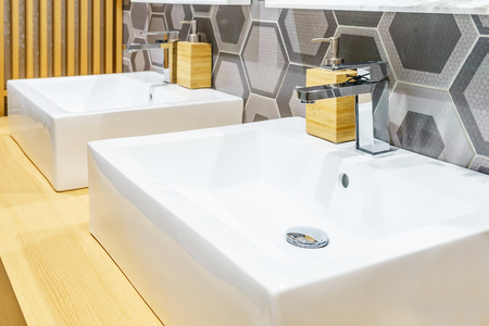 Interior of bathroom with sink basin faucet and mirror. Modern design of bathroom Imagens