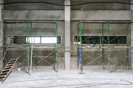 concrete wall renovation scaffold structure construction building restoration Stock Photo