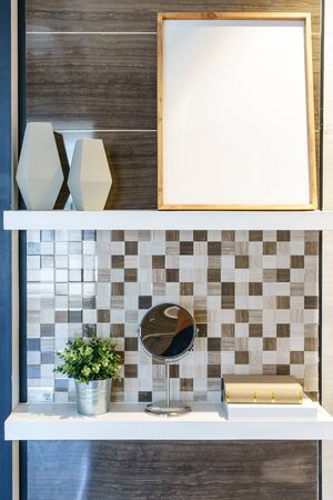 Delightful Wooden Wall Shelf With Decorative Items In Bathroom Interior Stock Photo    89269901