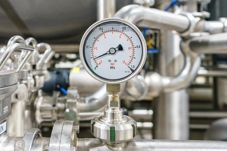 Pressure gauge, measuring instrument close up on pneumatic control system.