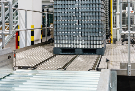 Canned food stacking on plastic pallet in Automated HighLow-level Depalletizer Machine