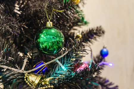 Christmas decoration with many glitter bauble balls, shinny baubles and pine cones on the artificial pine tree Stock Photo