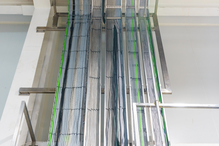The electrical wiring of building,a cable tray system used to support insulation electrical cables.